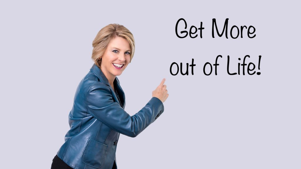"""Debbie O'Connell pointing to """"Get More out of Life!"""""""