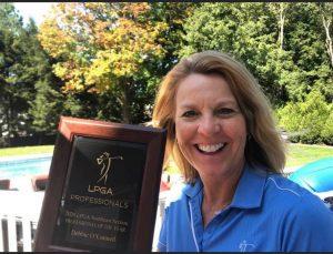 Debbie holding her LPGA Professional Award