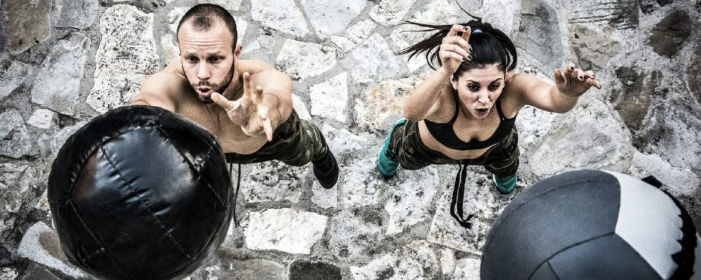 A couple doing HIIT training
