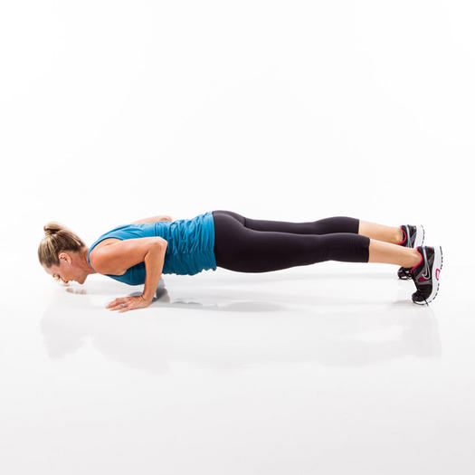 A woman showing burpees pose