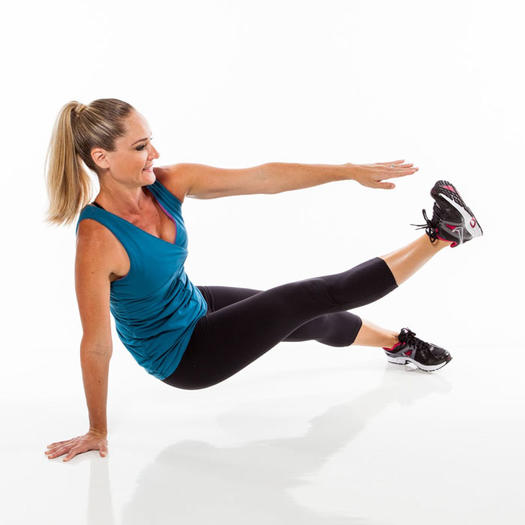 A woman performing the kicking plank