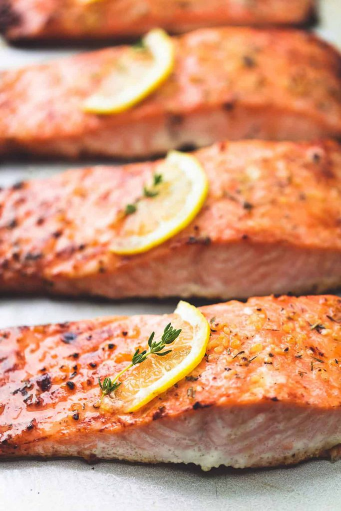 baked salmon with lemon slices on top